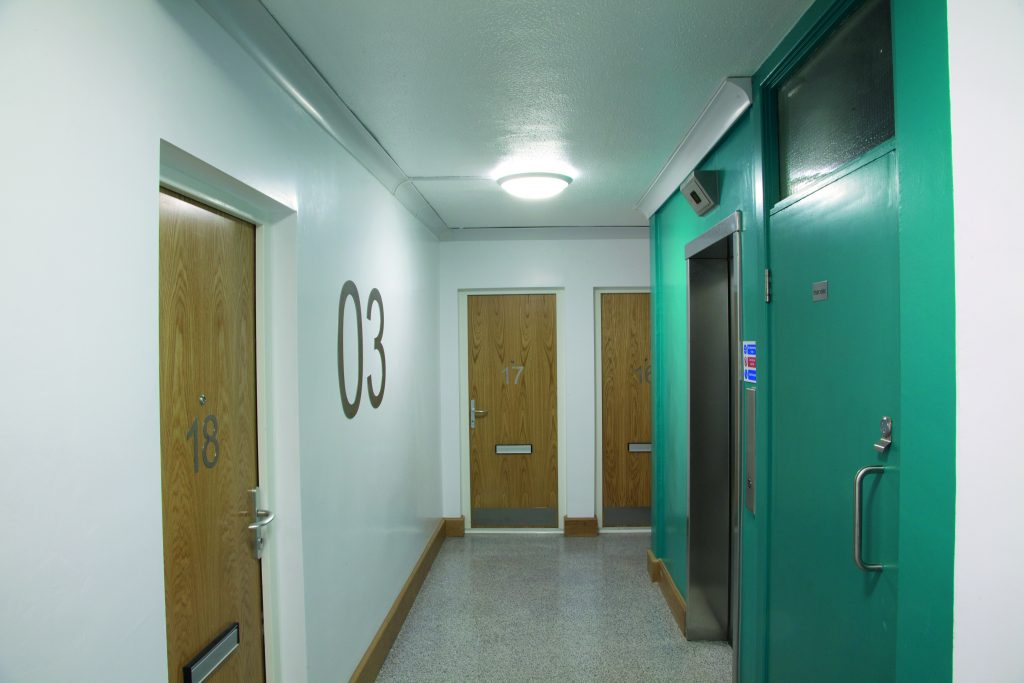 Luminaires installed within communal social housing area.
