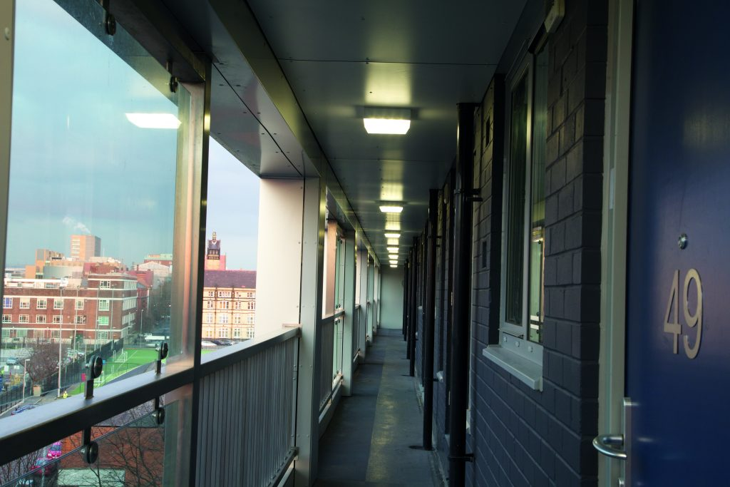 Luminaires installed in external areas of social housing environments.